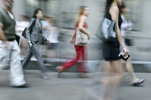 7267397-walking-business-people-rushing-on-the-street-in-intentional-motion-blur