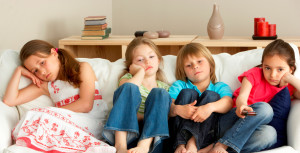 Young Children Watching Television at Home