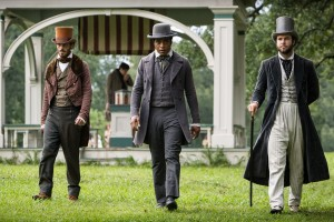 "During a chance meeting with alleged circus promoters Mr. Brown (Scoot McNairy, left) and Mr. Hamilton (Taran Killam, right), African-American free man Solomon Northup (Chiwetel Ejiofor, center) unwittingly embarks on a dark journey that tests his will to survive in director Steve McQueen's ""12 Years a Slave."" Photo courtesy of Fox Searchlight Pictures."