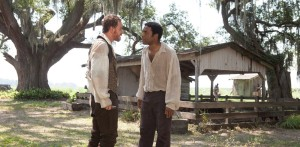 "The brutal treatment doled out by plantation owner Master Edwin Epps (Michael Fassbender, left) frequently pushes the limits of Solomon Northup (Chiwetel Ejiofor, right), an African-American free man illegally sold into slavery, in the dramatic new release, ""12 Years a Slave."" Photo courtesy of Fox Searchlight Pictures."