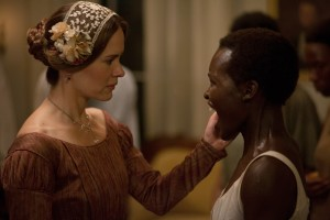 "Perennially jealous plantation wife Mistress Epps (Sarah Paulson, left) frequently and vociferously objects to the affections her husband routinely shows to Patsey (Lupita Nyong'o, right), one of the estate's slaves, in the cinematic adaptation of ""12 Years a Slave,"" based on Solomon Northup's memoir of the same name. Photo courtesy of Fox Searchlight Pictures."