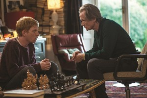 "When it comes to lessons in extraordinary temporal mechanics, apprentice time traveler Tim Lake (Domhnall Gleeson, left) learns the ropes from his kindly father (Bill Nighy, right) in director Richard Curtis's ""About Time."" Photo by Murray Close, courtesy of Universal Studios."