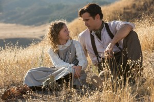 "Growing up in rural Australia at the turn of the century, a youthful version of Mary Poppins author P.L. Travers (Annie Rose Buckley, left) shares a tender moment with her doting father (Colin Farrell, right) in one of many flashback sequences in the charming new release, ""Saving Mr. Banks."" Photo by François Duhamel, © Disney Enterprises, Inc."