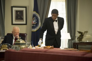 "Beginning with the administration of Dwight Eisenhower (Robin Williams, left), White House butler Cecil Gaines (Forest Whitaker, right) served seven Presidents during his tenure at 1600 Pennsylvania Ave., as seen in ""Lee Daniels' The Butler."" Photo courtesy of The Weinstein Co."