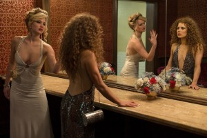 "Romantic rivals Rosalyn Rosenfeld (Jennifer Lawrence, left) and Sydney Prosser (Amy Adams, right) square off amidst the backdrop of the FBI undercover sting Abscam in the hilarious new period piece comedy, ""American Hustle."" Photo by François Duhamel, © Annapurna Productions LLC, courtesy of Columbia Pictures."