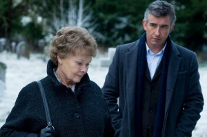 "The search to find a long-lost child ends up being a journey of self-discovery for retired nurse Philomena Lee (Judi Dench, left) and former BBC correspondent Martin Sixsmith (Steve Coogan, right) in the delightful new release, ""Philomena."" Photo by Alex Bailey, courtesy of The Weinstein Co."