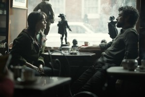 """Folk singer Llewyn Davis (Oscar Isaac, right) shares one of many contentious moments with fellow artist and clandestine romantic interest Jean Berkey (Carey Mulligan, left) in the Coen Brothers' new period piece drama, """"Inside Llewyn Davis."""" Photo by Alison Rosa © 2012 Long Strange Trip LLC, courtesy of CBS Films."""