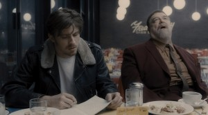 """Eccentric jazz musician Roland Turner (John Goodman, right) and his enigmatic cohort Johnny Five (Garrett Hedlund, left) make for strange road trip companions in the Coen Brothers' """"Inside Llewyn Davis."""" Photo courtesy of CBS Films."""