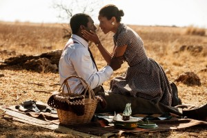 """The courtship of Winnie Mandela (Naomie Harris, right) by her future husband Nelson (Idris Elba, left) showcases one of the bright spots in the life of the South African human rights activist in director Justin Chadwick's """"Mandela: Long Walk to Freedom."""" Photo by Keith Bernstein, courtesy of The Weinstein Co."""