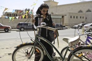 """To buy or not to buy? That's the question faced by Saudi schoolgirl Wadjda (Waad Mohammed) when it comes to purchasing a bicycle for herself, a culturally radical act, in the heartwarming release, """"Wadjda,"""" now available on DVD and Blu-ray disk. Photo by Tobias Kownatzki © Razor Film, courtesy of Sony Pictures Classics."""