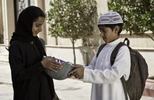 """In challenging her neighbor, Abdullah (Abdullrahman Al Gohani, right), to a bike race, Saudi schoolgirl Wadjda (Waad Mohammed, left) breaches cultural taboos rife with potentially sweeping consequences, as depicted in the heartwarming film, """"Wadjda."""" Photo by Tobias Kownatzki © Razor Film, courtesy of Sony Pictures Classics."""