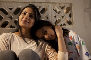 """Tomboyish Saudi schoolgirl Wadjda (Waad Mohammed, right) often gets frustrated when reined in by her more conservative, traditionalist mother (Reem Abdullah, left) in director Haifaa Al Mansour's debut fictional feature, """"Wadjda."""" Photo by Tobias Kownatzki © Razor Film, courtesy of Sony Pictures Classics."""