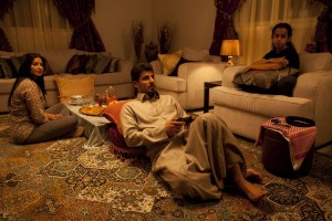 """Enterprising Saudi schoolgirl Wadjda (Waad Mohammed, right) frequently faces opposition to her plans from her conservative mother (Reem Abdullah, left) and surprising support from her less traditional father (Sultan Al Assaf, center) in director Haifaa Al Mansour's """"Wadjda."""" Photo by Tobias Kownatzki © Razor Film, courtesy of Sony Pictures Classics."""