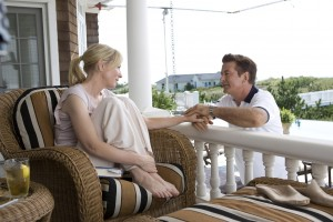 """In happier times, New York socialite Jasmine (Cate Blanchett, left) enjoys life at her summer house with husband Hal (Alec Baldwin, right) in the melancholy comedy, """"Blue Jasmine."""" Photo by Jessica Miglio © 2013 Gravier Productions, courtesy of Sony Pictures Classics."""