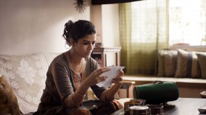 """Ila (Nimrat Kaur), a housewife ignored by her husband, has her spirits lifted when she receives a note of gratitude for her culinary skills from a stranger, in director Ritesh Batra's debut feature, """"The Lunchbox."""" Photo by Michael Simmonds, courtesy of Sony Pictures Classics."""
