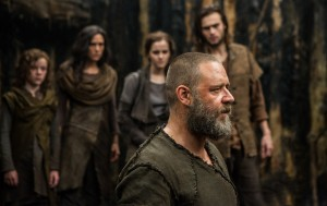 "The divinely inspired mission of saving the earth's animal life from a worldwide catastrophe is the daunting task undertaken by Noah (Russell Crowe, foreground) and his family, including (background, from left) his youngest son Japheth (Leo McHugh Carroll), his wife Naameh (Jennifer Connelly), his adopted daughter Ila (Emma Watson) and his eldest son Shem (Douglas Booth), in director Darren Aronofsky's ""Noah."" Photo by Niko Tavernise, courtesy of Paramount Pictures and Regency Enterprises."