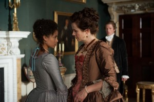 """Unlikely aristocrat Dido Elizabeth Belle (Gugu Mbatha-Raw, left) receives advice about her impending betrothal to admiring suitor Oliver Ashford (James Norton, right) from her stern but loving aunt, Lady Mansfield (Emily Watson, center), in the new period piece drama, """"Belle."""" Photo courtesy of Fox Searchlight Pictures."""