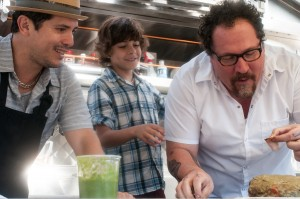 "Faced with having to set a new direction in his career, chef Carl Casper (Jon Favreau, right) embarks on an unlikely new culinary adventure as a food truck operator, aided by his longtime kitchen colleague, Martin (John Leguizamo, left), and his son, Percy (Emjay Anthony, center), in director Jon Favreau's new independent comedy, ""Chef."" Photo by Merrick Morton, courtesy of Open Road Films."