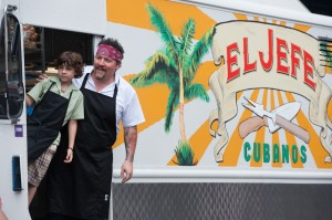 "Operating a food truck provides chef Carl Casper (Jon Favreau, right) with an opportunity to bolster his relationship with his young son, Percy (Emjay Anthony, left), in director Jon Favreau's ""Chef."" Photo by Merrick Morton, courtesy of Open Road Films."