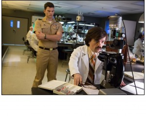 "Weapons developer Dr. Bolivar Trask (Peter Dinklage, foreground) works on creating specialized robotic technology aimed at targeting and wiping out the mutant ""threat"" against humanity in director Bryan Singer's ""X-Men: Days of Future Past."" Photo by Alan Markfield, courtesy of Twentieth Century Fox Film Corporation."