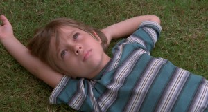 """Six-year-old Mason (Eller Coltrane) wonders what awaits him on the beginning of his journey into this thing we call life in director Richard Linklater's ambitious new release, """"Boyhood,"""" a project that took 12 years to film. Photo by Matt Lankes, courtesy of IFC Films."""