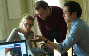 """Molecular biologist Dr. Ian Gray (Michael Pitt, center) seeks to definitively prove the theory of evolution with the aid of his research assistant, Karen (Brit Marling, left), and fellow grad student, Kenny (Steven Yeun, right), in the unusual new science fiction release, """"I Origins."""" Photo courtesy of Fox Searchlight Pictures."""
