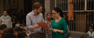 """After a series of unexpected interactions, such as an encounter with an Indian community center worker (Archie Panjabi, right), molecular biologist Dr. Ian Gray (Michael Pitt, left) is on the verge of an earth-shattering discovery in director Mike Cahill's """"I Origins."""" Photo courtesy of Fox Searchlight Pictures."""