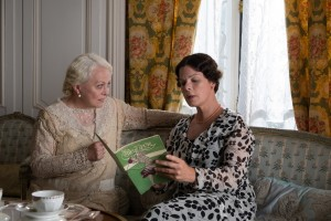 "Wealthy socialite Grace Catledge (Jacki Weaver, left) discusses financial arrangements for psychic services with Mrs. Baker (Marcia Gay Harden, right), mother and manager of a supposedly gifted spirit medium, in ""Magic in the Moonlight."" Photo by Jack English © 2014 Gravier Productions, courtesy of Sony Pictures Classics."