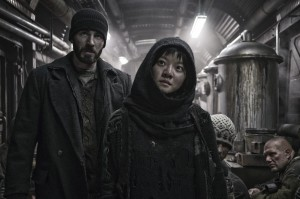 """Rebel leader Curtis (Chris Evans, left) attempts to orchestrate a rebellion to improve living conditions aboard a post-apocalyptic survival train with a ragtag band of followers, including a young psychic girl, Yona (Ko Ah-sung, right), in """"Snowpiercer."""" Photo courtesy of Radius-TWC."""