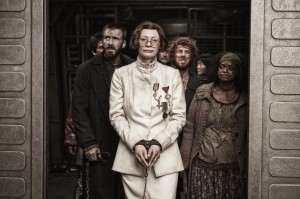 """Mason (Tilda Swinton, center), a perfunctory minion of the power elite aboard a post-apocalyptic survival train, does battle with a band of rebels led by Curtis (Chris Evans, left) and his compatriot Tanya (Octavia Spencer, right) in their efforts to improve the living conditions of the underprivileged in director Bong Joon-ho's incredible cinematic thrill ride, """"Snowpiercer."""" Photo courtesy of Radius-TWC."""