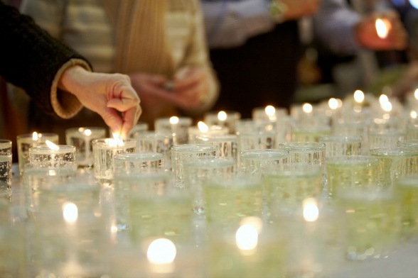 bigstock-Hands-lighting-funeral-candles-41289436