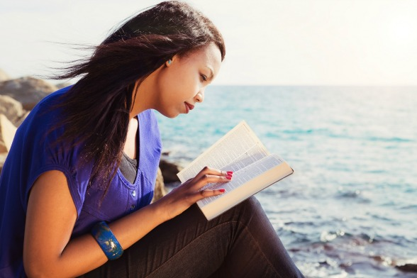 bigstock-Young-Girl-Studying-Her-Bible--64618498