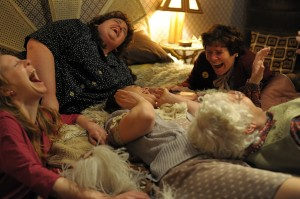 """Members of the women's auxiliary of the Onllwyn miners' lodge (from left, Nia Gwynne, Jessica Gunning, Liz White, Menna Trussler, Imelda Staunton) share a laugh in the inspiring new comedy, """"Pride."""" Photo by Nicole Dove, courtesy of CBS Films."""