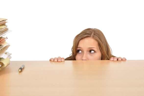 bigstock-Young-Woman-Hiding-Behind-The--21882821