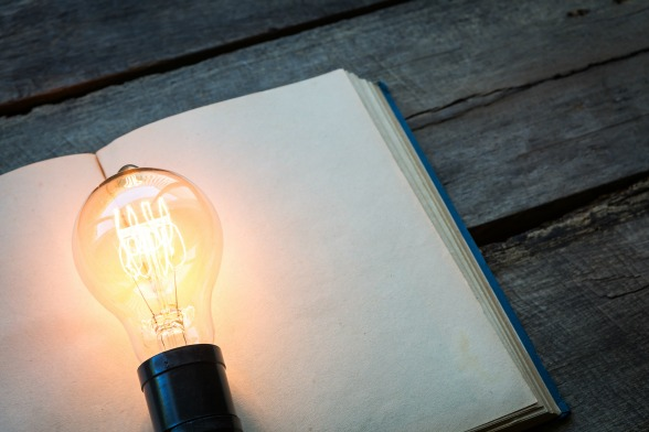 bigstock-vintage-book-and-light-bulb-on-66700750