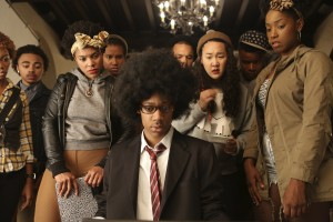 """Unfocused undergrad Lionel Higgins (Tyler James Williams, seated, center) looks for direction in his personal life and college pursuits in the edgy new comedy, """"Dear White People."""" Photo by Ashley Nguyen, courtesy of Roadside Attractions."""