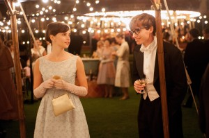 "Cambridge University cosmology student Stephen Hawking (Eddie Redmayne, right) woos a beautiful language arts major, Jane Wilde (Felicity Jones, left), in the inspiring new biopic, ""The Theory of Everything."" Photo by Liam Daniel, courtesy of Focus Features."