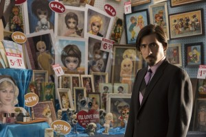 """Ruben, an upscale contemporary art dealer in San Francisco (Jason Schwartzman), rolls his eyes at the phenomenal sales success of the kitschy, doe-eyed Keane portraits in the fact-based comedy, """"Big Eyes."""" Photo courtesy of The Weinstein Co."""