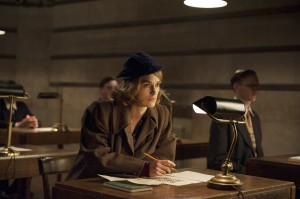 "Joan Clarke (Keira Knightley), a whizz at solving crossword puzzles, proves to be a natural at code breaking, a talent that proves crucial to the Allied campaign in World War II in director Morten Tyldum's latest release, ""The Imitation Game."" Photo by Jack English, courtesy of The Weinstein Co."