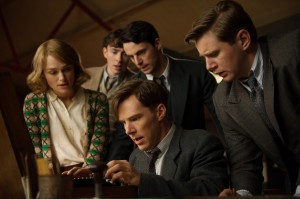 "A team of intrepid code breakers seeks to decipher the Germans' inscrutable code known as Enigma in ""The Imitation Game."" Team members include (clockwise from front center) Alan Turing (Benedict Cumberbatch), Joan Clarke (Keira Knightley), Peter Hilton (Matthew Beard), Hugh Alexander (Matthew Goode) and John Cairncross (Allen Leech). Photo by Jack English, courtesy of The Weinstein Co."