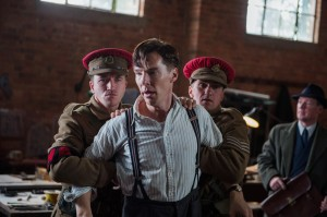 "Under pressure to deliver on his promises, code breaker team leader Alan Turing (Benedict Cumberbatch, center) is threatened with removal from his own project in ""The Imitation Game."" Photo by Jack English, courtesy of The Weinstein Co."