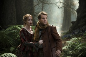 """A young baker (James Corden, right) and his wife (Emily Blunt, left) long for a child, but a witch's curse keeps them from realizing their dream in the delightful new movie musical, """"Into the Woods."""" Photo by Peter Mountain, courtesy of Disney Enterprises, Inc."""