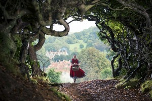 """As Spunky Little Red Riding Hood (Lilla Crawford) heads out to visit her grandmother in the forest, she has no idea what adventures await her there in director Rob Marshall's new movie musical, """"Into the Woods."""" Photo by Peter Mountain, courtesy of Disney Enterprises, Inc."""