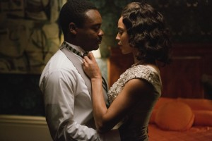 "The pressures of the civil rights movement and rumors of alleged infidelities intensify difficulties already present in the sometimes-troubled marriage of activist Dr. Martin Luther King, Jr. (David Oyelowo, left) and his wife, Coretta (Carmen Ejogo, right), in ""Selma."" Photo by Atsushi Nishijima, courtesy of Paramount Pictures."