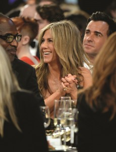 """Jennifer Aniston (center) delivers a breakthrough performance as a woman beset with chronic pain in the engaging drama, """"Cake,"""" a portrayal that earned her a Screen Actors Guild Award nomination for best lead actress. Aniston is seen here celebrating her nomination at the competition's awards ceremony, held last month in Los Angeles. Photo by Kevin Mazur/WireImage, courtesy of Getty Images."""