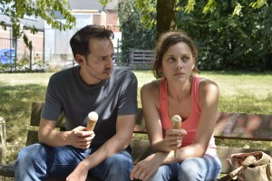 """Depressed over the prospect of losing her job, Sandra Bya (Marion Cotillard, right) seeks encouragement from her husband, Manu (Fabrizio Rongione, left), in """"Two Days, One Night."""" Photo courtesy of IFC Films."""