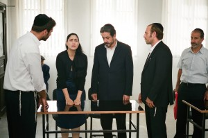 "Viviane Amsalem (Ronit Elkabetz, second from left), aided by her attorney, Carmel Ben Tovim (Menashe Noy, middle), battles an often-buffoonish yet surprisingly convincing opponent, Rabbi Shimon (Sasson Gabai, far right), in attempting to secure a divorce from her husband in the absorbing new Israeli drama, ""Gett: The Trial of Viviane Amsalem."" Photo courtesy of Music Box Films."