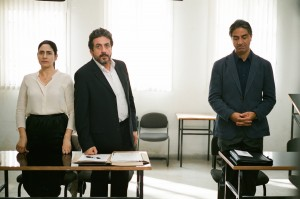"Elisha (Simon Abkarian, right), an intractable, quietly vindictive spouse, refuses to grant a divorce to his wife, Viviane (Ronit Elkabetz, left), despite her best efforts and the fervent advocacy of her attorney, Carmel (Menashe Noy, center), in ""Gett: The Trial of Viviane Amsalem."" Photo courtesy of Music Box Films."