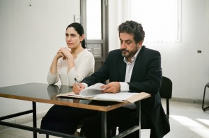 "Viviane Amsalem (Ronit Elkabetz, left), a woman trapped in a loveless marriage, consults her attorney, Carmel Ben Tovim (Menashe Noy, right), in seeking a divorce from her indifferent husband in ""Gett: The Trial of Viviane Amsalem."" Photo courtesy of Music Box Films."