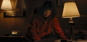"""Kumiko (Rinko Kikuchi), a Tokyo """"office lady"""" bored with her life, sets off to seek her fortune a world away in the quirky new comedy-drama, """"Kumiko, the Treasure Hunter."""" Photo by Sean Porter, courtesy of Amplify Releasing."""